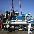 FG Wilson P880E being lifted off Truck